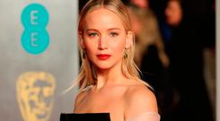 US actress Jennifer Lawrence poses on the red carpet upon arrival at the BAFTA British Academy Film Awards at the Royal Albert Hall in London on February 18, 2018. / AFP PHOTO / Daniel LEAL-OLIVASDANIEL LEAL-OLIVAS/AFP/Getty Images