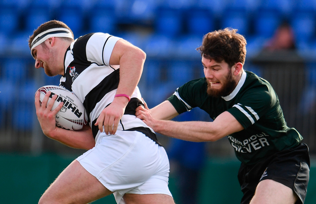 Belvedere College's James Gleeson is challenged by Newbridge College's Dylan Morrissey. Photo: Sportsfile