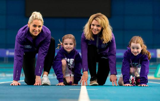 RTÉ sports broadcaster Evanne Ní Chuilinn, Mia Horgan (7), from Castleknock, with her sister Amy (5), and actress Denise McCormack at the National Indoor Arena, Blanchardstown, for the launch of Cystic Fibrosis Ireland's One in 1,000 campaign. Photo: Shane O'Neill