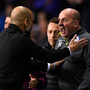 Pep Guardiola and Paul Cook exchange views on the sideline. Photo: Getty Images