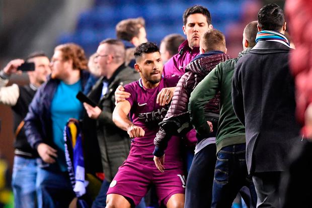Sergio Aguero clashes with a fan after Manchester City's defeat to Wigan last night. Photo: Getty