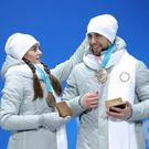 Anastasia Bryzgalova (left) and Alexander Krushelnitsky have been stripped of their Olympic bronze medals Getty