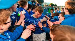 Adam McEvoy of St Mary's College celebrates with supporters