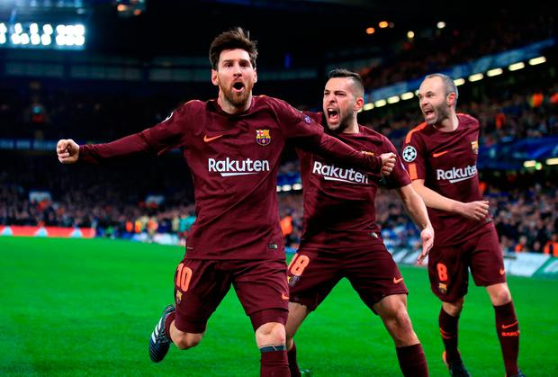 Barcelona's Lionel Messi (left) celebrates scoring his side's first goal