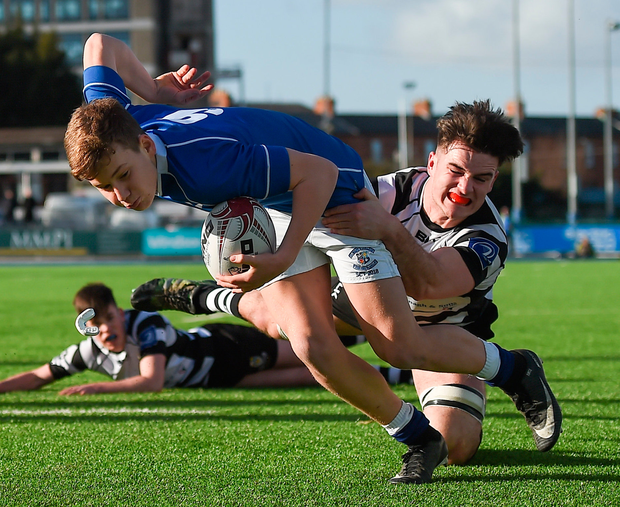 St Mary's College Adam McEvoy is challenged Cistercian College Roscrea's James Corcoran before scoring his side's first try. Photo: Sportsfile