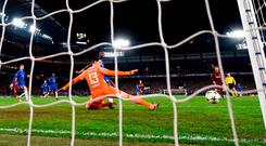 Thibaut Courtois is left helpless as Lionel Messi scores for Barcelona at Stamford Bridge. Photo: Mike Hewitt/Getty Images