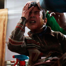 Ghaith, a wounded 12-year-old boy, cries as he receives treatment at a make-shift hospital. Photo: Getty Images