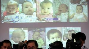 The surrogate babies are shown at a police news conference. Photo: Reuters