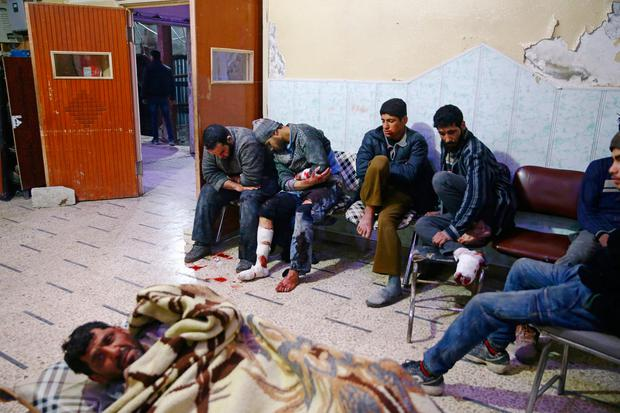 People sit a medical point in the besieged town of Douma, Eastern Ghouta, Damascus, Syria February 20, 2018. REUTERS/Bassam Khabieh TEMPLATE OUT