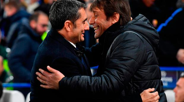 Ernesto Valverde (L) and Chelsea's Antonio Conte greet before the first leg