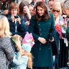 Catherine, Duchess of Cambridge greets members of the crowd as she visits The Fire Station, one of Sunderlands most iconic buildings, recently converted into a music and arts hub on February 21, 2018 in Sunderland, England