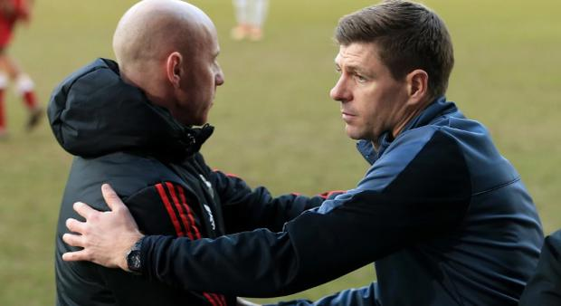 Steven Gerrard gives Nicky Butt a pat on the back after Liverpool U19s defeated Man Utd's youngsters. CREDIT: GETTY IMAGES