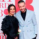 Cheryl Tweedy and Liam Payne arrive at the Brit Awards at the O2 Arena in London, Britain, February 21, 2018. REUTERS/Eddie Keogh
