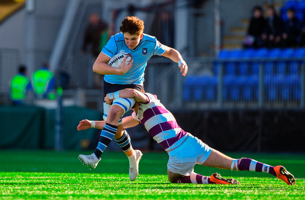 Dan O'Donovan of St Michael's College is tackled by Ben O'Shea of Clongowes Wood Photo: David Fitzgerald/Sportsfile