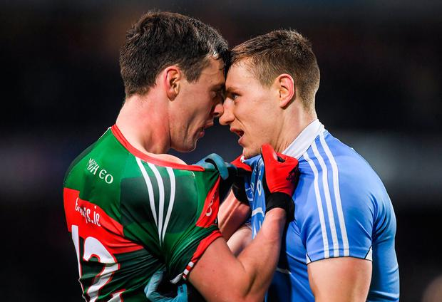 Diarmuid O'Connor and John Small clash during the Allianz Football League match between Dublin and Mayo at Croke Park last March. Photo: Brendan Moran/Sportsfile