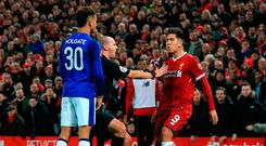 Everton's Mason Holgate (L) squares up with Liverpool's Roberto Firmino Photo: Peter Byrne/PA Wire