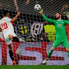 Manchester United's David De Gea makes a save from Sevilla's Luis Muriel. REUTERS/Jon Nazca