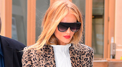 'Rosie Huntington-Whiteley opted for Gucci's Marmont bag for New York Fashion Week, peeking out discreetly from underneath a leopard-print coat' Photo: Robert Kamau/GC Images