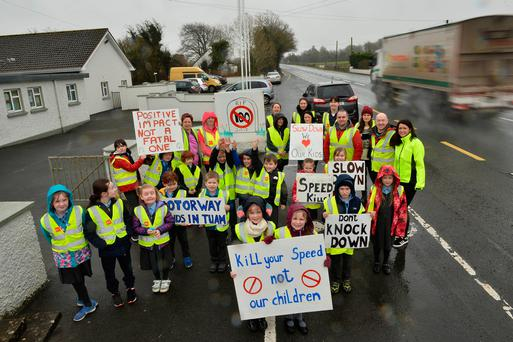 Pupils, parents and teachers outside Milltown National School. Photo: Ray Ryan