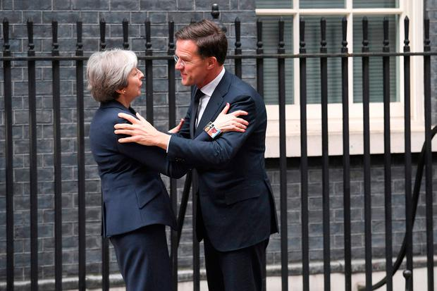 British Prime Minister Theresa May greets the Dutch PM Mark Rutte outside 10 Downing Street yesterday. Photo: PA