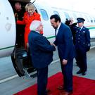 President Michael D Higgins and his wife Sabina are greeted by Minister Nikos Pappas in Athens yesterday at the start of their state visit to Greece. Photo: Maxwell Photography