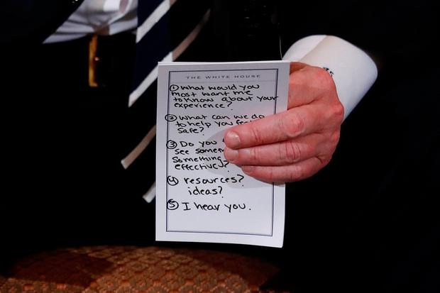 U.S. President Donald Trump holds his prepared questions as he hosts a listening session with high school students and teachers to discuss school safety at the White House in Washington, U.S., February 21, 2018. REUTERS/Jonathan Ernst