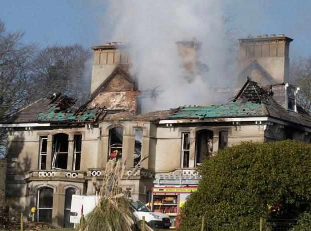 Firefighters tackle the blaze that destroyed Donaghmore House on the outskirts of Castlefin in Co Donegal. Photo: North West Newspix