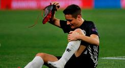 Manchester United's Ander Herrera takes off his boot after sustaining an injury REUTERS/Jon Nazca