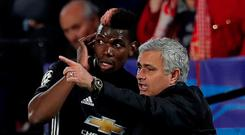 Manchester United manager Jose Mourinho speaks with Paul Pogba during the game. Action Images via Reuters/Andrew Couldridge
