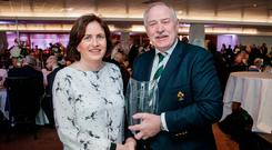 Maeve Lenehan being presented with her award by IRFU president Philip Orr. Photo: ©INPHO/Ryan Byrne
