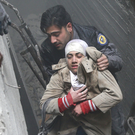The Syria Civil Defence helps an unconscious woman from a shelter in Douma. Photo: Reuters