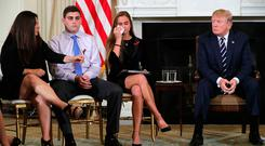 Donald Trump, right, hosts a listening session with Marjory Stoneman Douglas High School survivors and their relatives at the White House. Photo: Getty Images