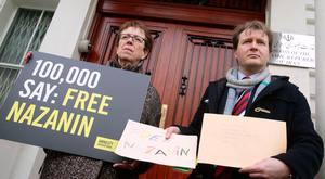 Richard Ratcliffe (right), the husband of jailed mother Nazanin Zaghari-Ratcliffe, and Kate Allen, from Amnesty International, hand in a letter to the Iranian Embassy in London. Photo: PA