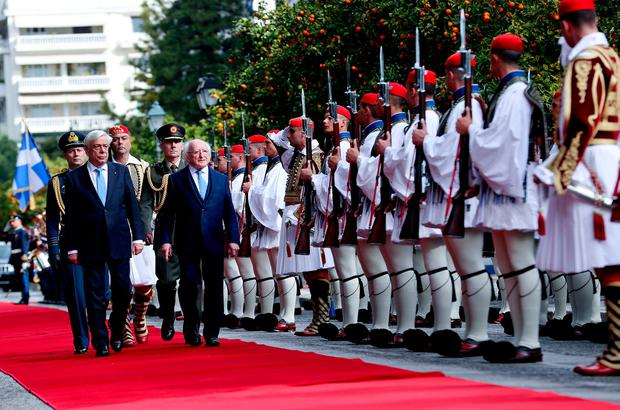 President Michael D Higgins with his Greek counterpart Prokopis Pavlopoulos at a welcoming ceremony in Athens