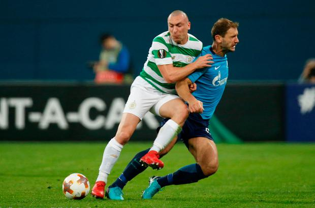 Celtic's Scott Brown in action with Zenit St. Petersburg's Branislav Ivanovic. Photo: Reuters