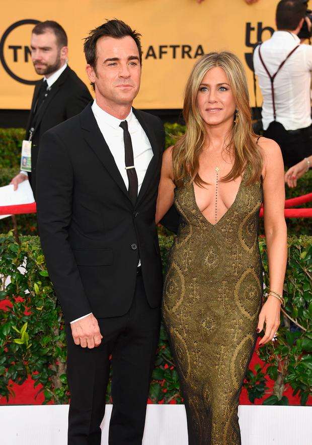 Justin Theroux (L) and Jennifer Aniston attend the 21st Annual Screen Actors Guild Awards at The Shrine Auditorium on January 25, 2015 in Los Angeles, California. (Photo by Ethan Miller/Getty Images)