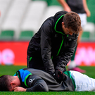 Johny Sexton receives treatment from team physio Colm Fuller during the captain's run