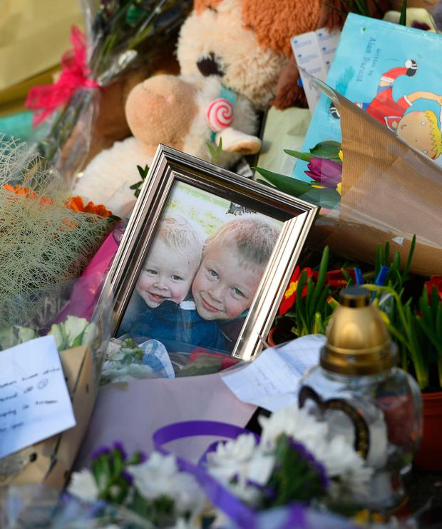 Flowers close to the scene where brothers Corey Platt-May and Casper, aged six and two, were killed in a hit-and-run collision in Coventry after being struck by a car on Thursday afternoon. Photo: Joe Giddens/PA Wire