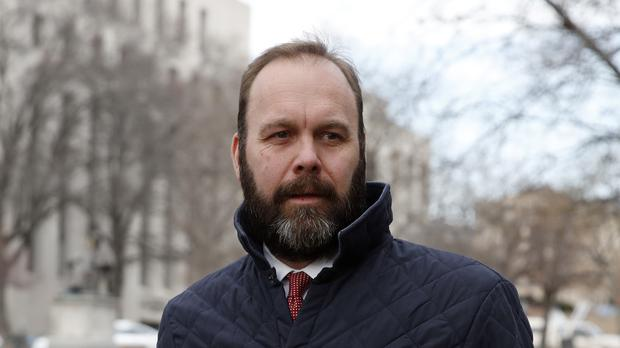 Rick Gates leaves the Federal District Court in Washington (Alex Brandon/AP)