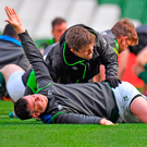 Jonathan Sexton receives treatment from team physio Colm Fuller during the Ireland Rugby captain's run at the Aviva Stadium in Dublin. Photo: Sportsfile