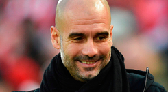 The FA has charged Pep Guardiola for wearing Catalonia political symbol Photo: OLI SCARFF/AFP/Getty Images