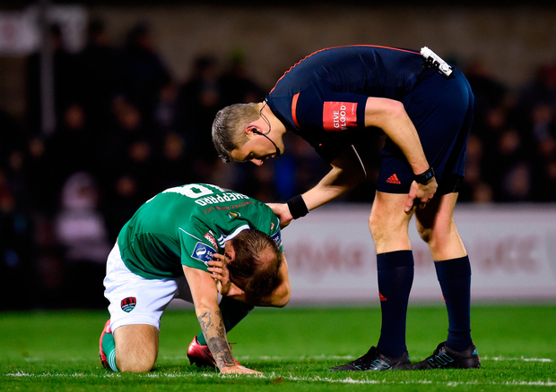 Referee Ben Connolly checks with Karl Sheppard of Cork City after he received a knock to the head Photo: Tom Beary/Sportsfile