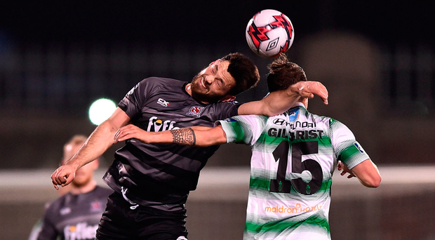 Dundalk's Patrick Hoban challenges Shamrock Rovers' Ally Gilchrist during last night's League of Ireland clash Photo: Seb Daly/Sportsfile