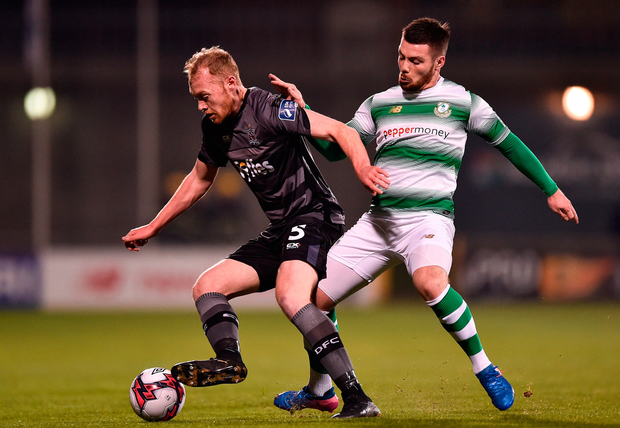 Dundalk's Chris Sheilds in action against Brandan Miele of Shamrock Rovers Photo: Seb Daly/Sportsfile