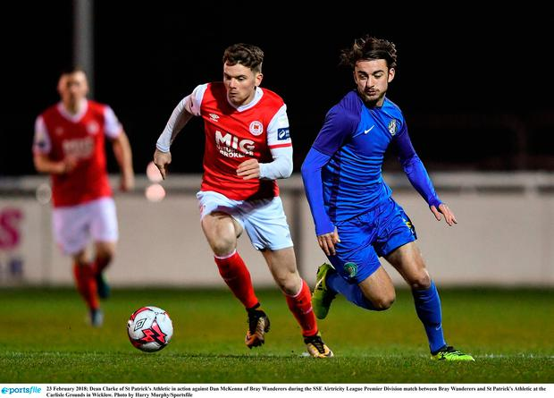 Dean Clarke of St Patrick's Athletic attempts to evade Bray's Dan McKenna Photo: Harry Murphy/Sportsfile