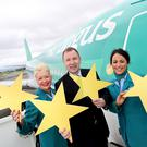 Aer Lingus CEO Stephen Kavanagh, pictured with cabin crew, said the airline is poised to lease another long-haul Airbus A330 and overall capacity will rise 9.7pc this year