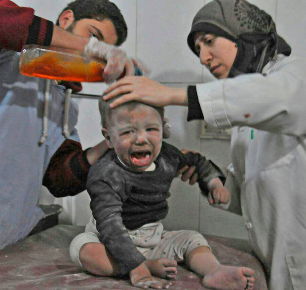 In this photo provided by the Syrian anti-government activist group Ghouta Media Centre, Syrian paramedics treat a child wounded during airstrikes and shelling by Syrian government forces, at a makeshift hospital, in Ghouta. Photo: AP