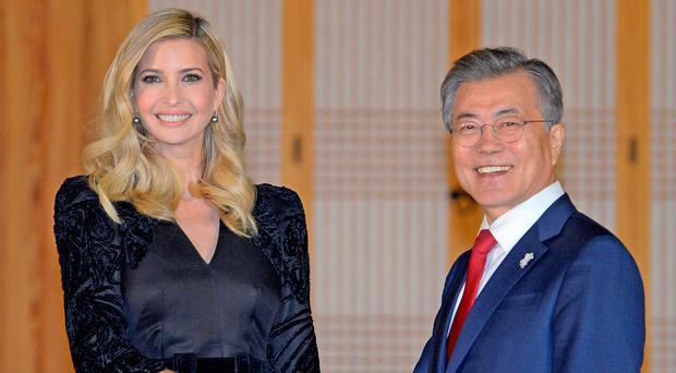 South Korean President Moon Jae-in shakes hands with Ivanka Trump during their dinner at the Presidential Blue House in Seoul, South Korea. Photo: Reuters