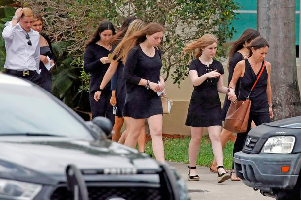 Mourners leave the funeral of Aaron Feis, one of the victims of the shooting at Marjory Stoneman Douglas High School, Florida, Photo: Reuters