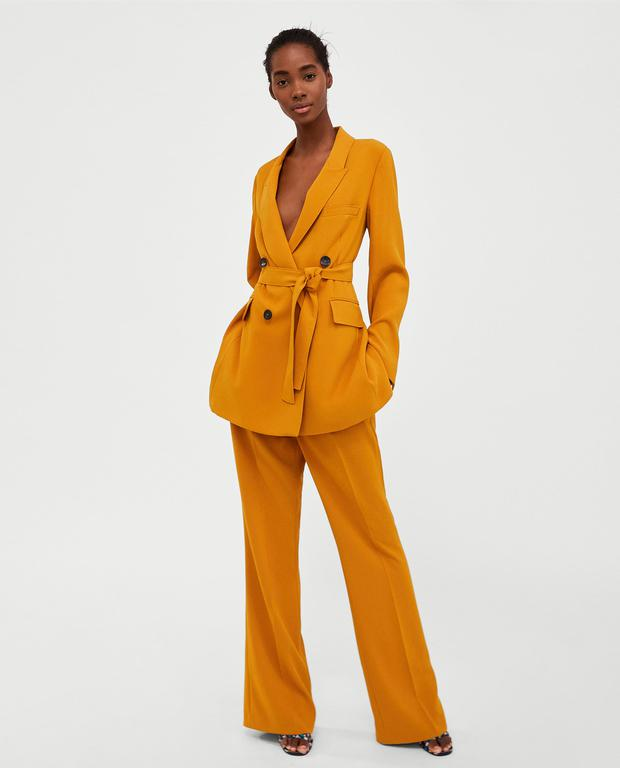 Long belted jacket, 79.95 EUR and flared trousers, 49.95 EUR, from ZARA